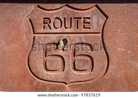 rusty steel route 66 sign with bullet hole - stock photo