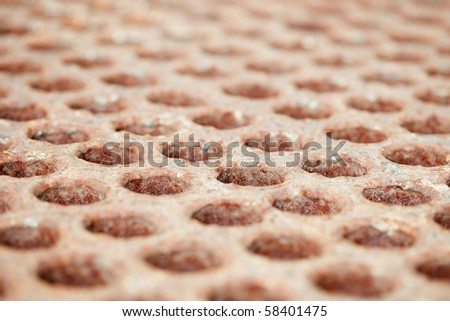 Rusty surface with holes - a close up - stock photo