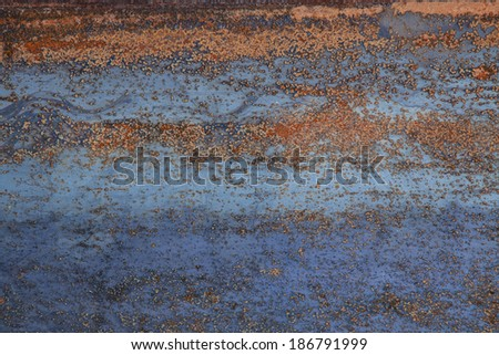 Rusty surface with horizontal structure - stock photo