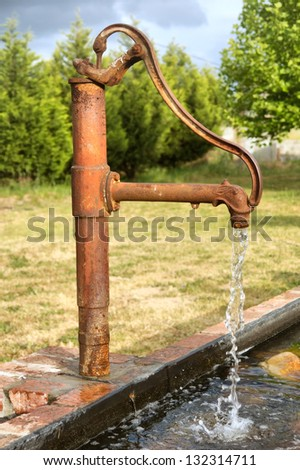 Rusty tap in sunset light. Shot in Franshoek, Western Cape, South Africa. - stock photo