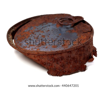 Rusty tin can isolated on white background. Selective focus. - stock photo
