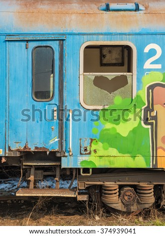 Rusty train wagon out of service with a window broken in a heart shape. love symbol