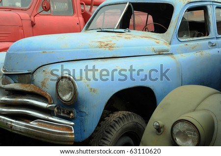 Rusty vintage cars in the graveyard in Russia - stock photo