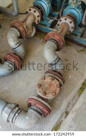 Rusty water tube - stock photo