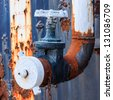 rusty water valve and tank - stock photo