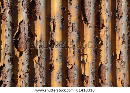 rusty waveform iron plate, can uesd as wallpaper - stock photo