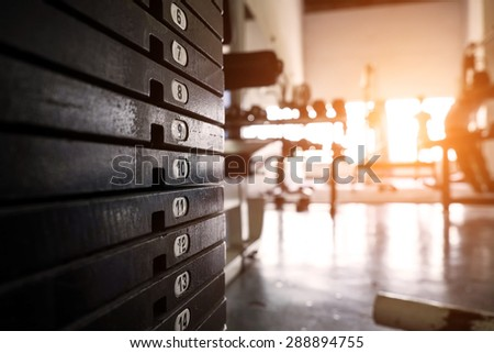 rusty weight stack in a gym - stock photo