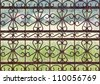 Rusty wrought iron gate, fence design. - stock photo