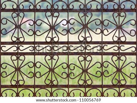 Rusty wrought iron gate, fence design. - stock photo