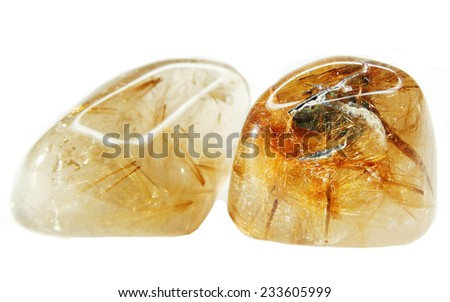 rutilated natural quartz semigem geode crystals geological mineral isolated  - stock photo