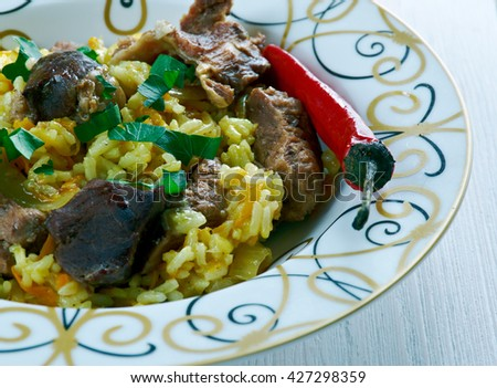 Ruzz bil Khaloot - Libyan rice with liver and almonds.African cuisine