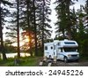RV and chairs at secluded campsite at sunset - stock photo