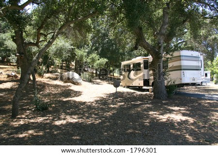 RV Camping in a Forrest Setting - stock photo