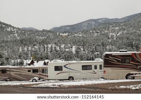 RV campsite in snow at Estes park, Colorado. - stock photo