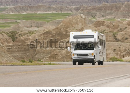 RV class C climbing scenic mountain road in the Badlands - stock photo