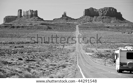 RV motorhome entering monument valley, utah - stock photo