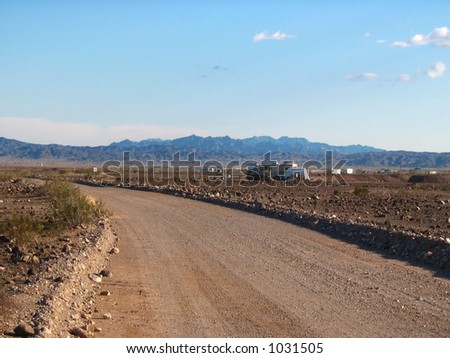 rv trailers parked along the road in the desert in Yuma Arizona - stock photo