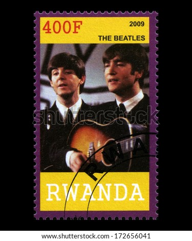 RWANDA, AFRICA - CIRCA 2009: A postage stamp from Rwanda portraying an image of John Lennon and Paul McCartney of The Beatles, circa 2009. - stock photo