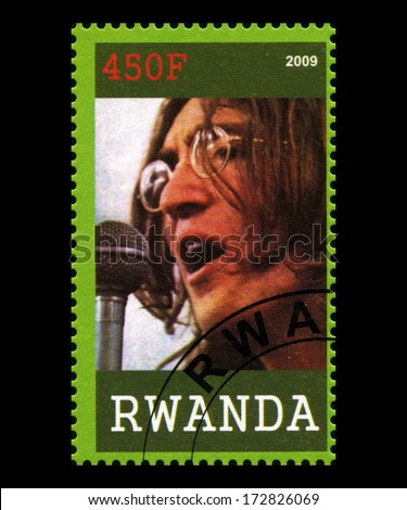 RWANDA, AFRICA - CIRCA 2009: A postage stamp from Rwanda portraying an image of John Lennon of The Beatles, circa 2009. - stock photo