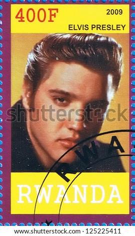 RWANDA - CIRCA 2009: A postage stamp printed in the Republic of Rwanda showing Elvis Aaron Presley, circa 2009 - stock photo