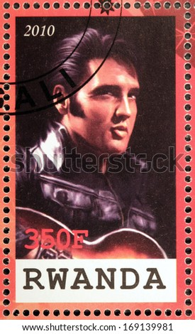 RWANDA - CIRCA 2010: A stamp printed by Republic of RWANDA shows image portrait of famous American singer Elvis Aaron Presley, circa 2010. - stock photo