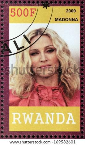 RWANDA - CIRCA 2009: A stamp printed by Rwanda shows famous American singer, songwriter, actress, author, director, entrepreneur and philanthropist Madonna Louise Ciccone, circa 2009 - stock photo
