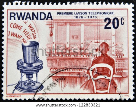 RWANDA - CIRCA 1976: A stamp printed in Rwanda dedicated to first telephone link, circa 1976