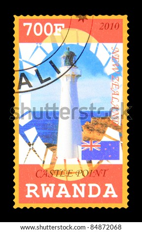 RWANDA - CIRCA 2010: A stamp printed in Rwanda showing Castle Point lighthouse, circa 2010 - stock photo