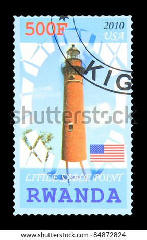 RWANDA - CIRCA 2010: A stamp printed in Rwanda showing Little Sable Point lighthouse, circa 2010 - stock photo