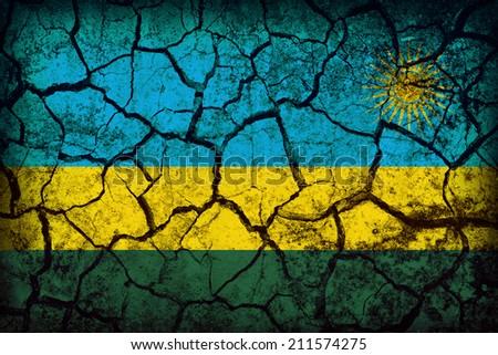 Rwanda flag pattern on the crack soil texture ,retro vintage style - stock photo