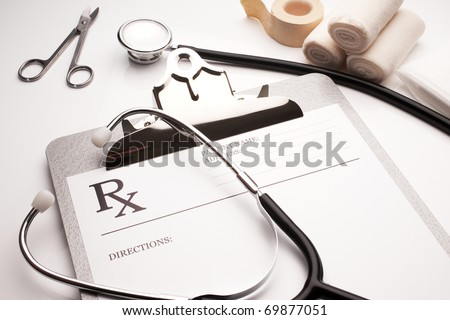 rx prescription concept stethoscope and bandages on white table - stock photo