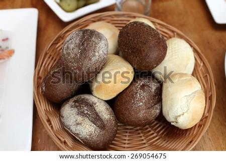 Rye and wheat bread in wicker basket - stock photo