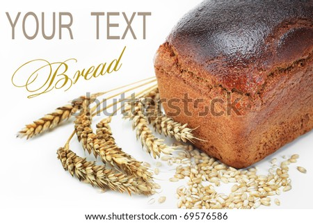 Rye bread and rye ear - stock photo