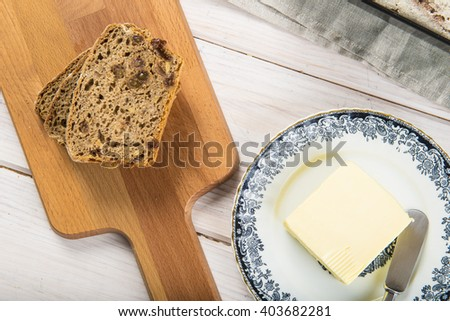 Rye bread and some butter to spread on the slices - stock photo