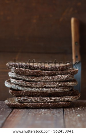Rye bread on a rustic background,shallow depth of field - stock photo