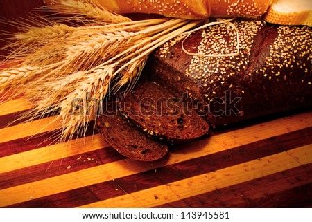 rye bread on wooden background - stock photo