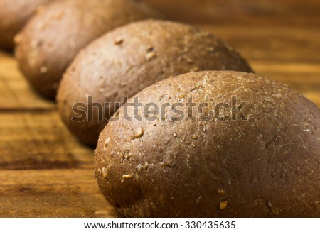 Rye bread on wooden background. - stock photo