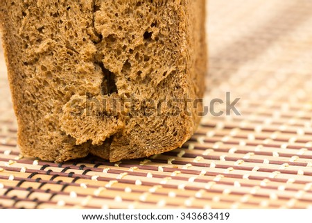 Rye bread pieces on the boards, closeup