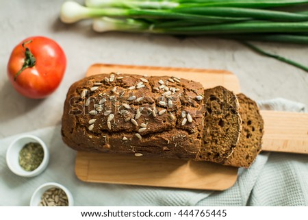 rye bread with sunflower seeds and herbs French - stock photo