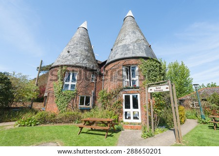 RYE, EAST SUSSEX, UK - APRIL 16: The unusual Playden Oasts Hotel. Originally built to dry hops for the brewing industry, it is now a popular folly hotel near Rye, East Sussex, UK - April 16, 2014 - stock photo