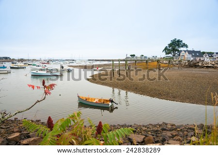 Rye Harbour at Hampton Beach, small fishing village in New Hampshire, USA at half tide with the exposed sand bank and the moored boats. - stock photo