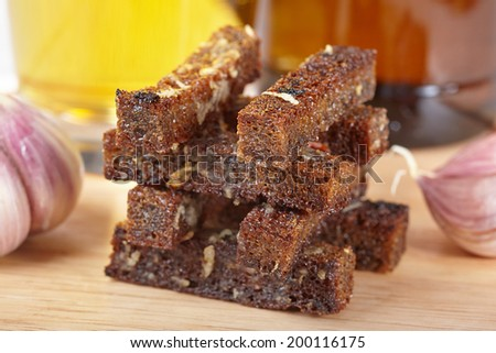 Rye rusks with garlic - stock photo