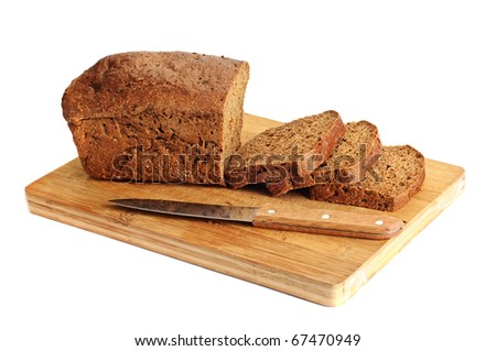 Rye sliced bread on the wooden desk - stock photo