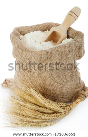 Rye spike and flour in burlap bag - stock photo