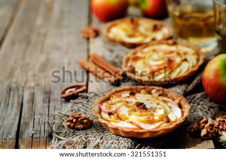 Rye tartlets with apples, cinnamon, honey and walnuts. toning. selective focus - stock photo