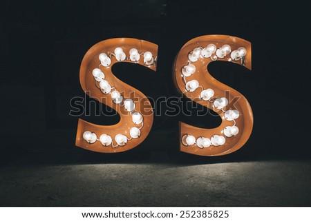 S Alphabet light bulb, Vintage Effect. - stock photo
