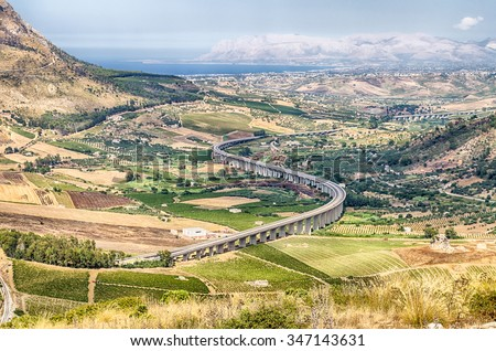 S-Curve Highway Overpass in the valley near Segesta, Sicily, Italy - stock photo