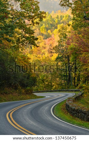 S-curve road on Skyline Drive, tucked into the blue ridge mountains in Shenandoah National Park, Virgina. - stock photo