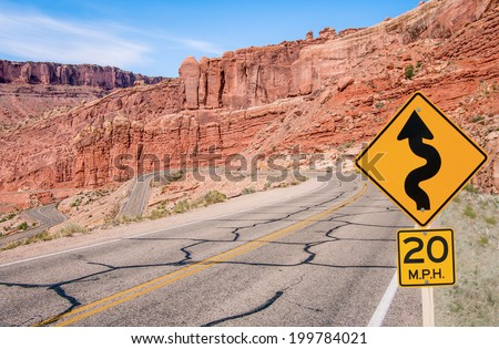S-Curves Sign:  A sign warns of sharp turns ahead on a road in southern Utah.  - stock photo