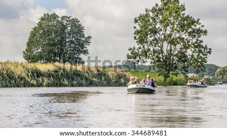 s-HERTOGENBOSCH, NETHERLANDS b AUGUST 28, 2015: Tourist guide in a boat on the canals of 's-Hertogebosch in the Netherlands. - stock photo